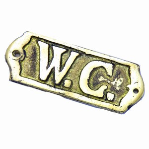 W.C. Brass Sign
